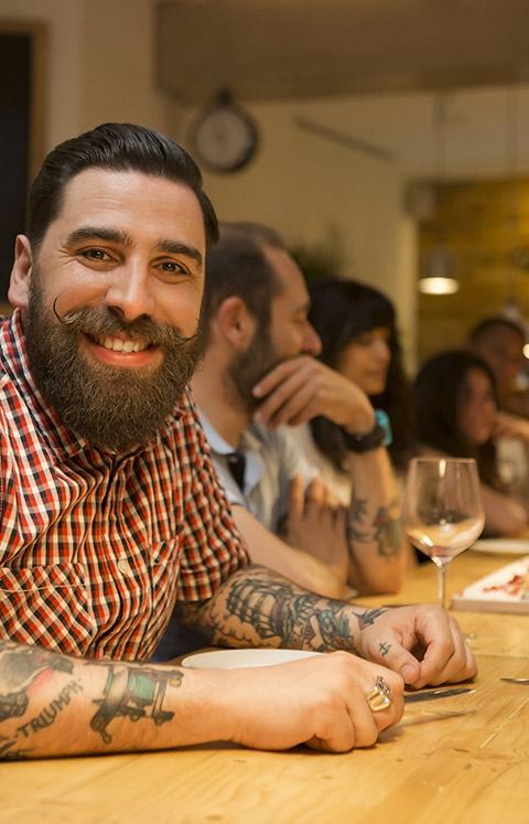 gentleman sitting at bar